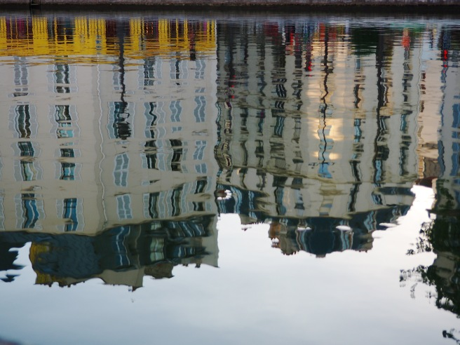 Reflection of the buildings in the placid canal.