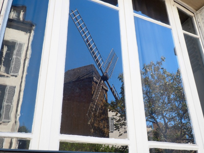 The lesser known, but perfectly lovely Moulin de la Galette, reflected in an old window pane.