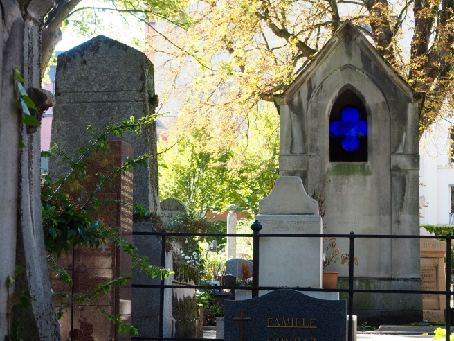 The cobalt blue of the stained glass in this particular grave caught my eye immediately.