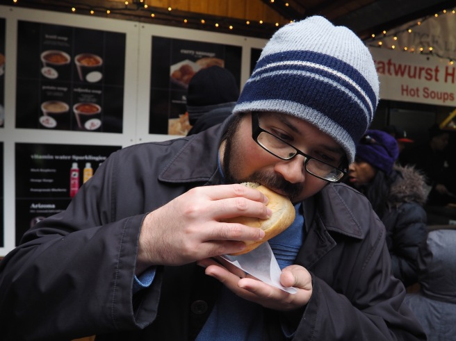 Eric enjoying a German bratwurst with sauerkraut.